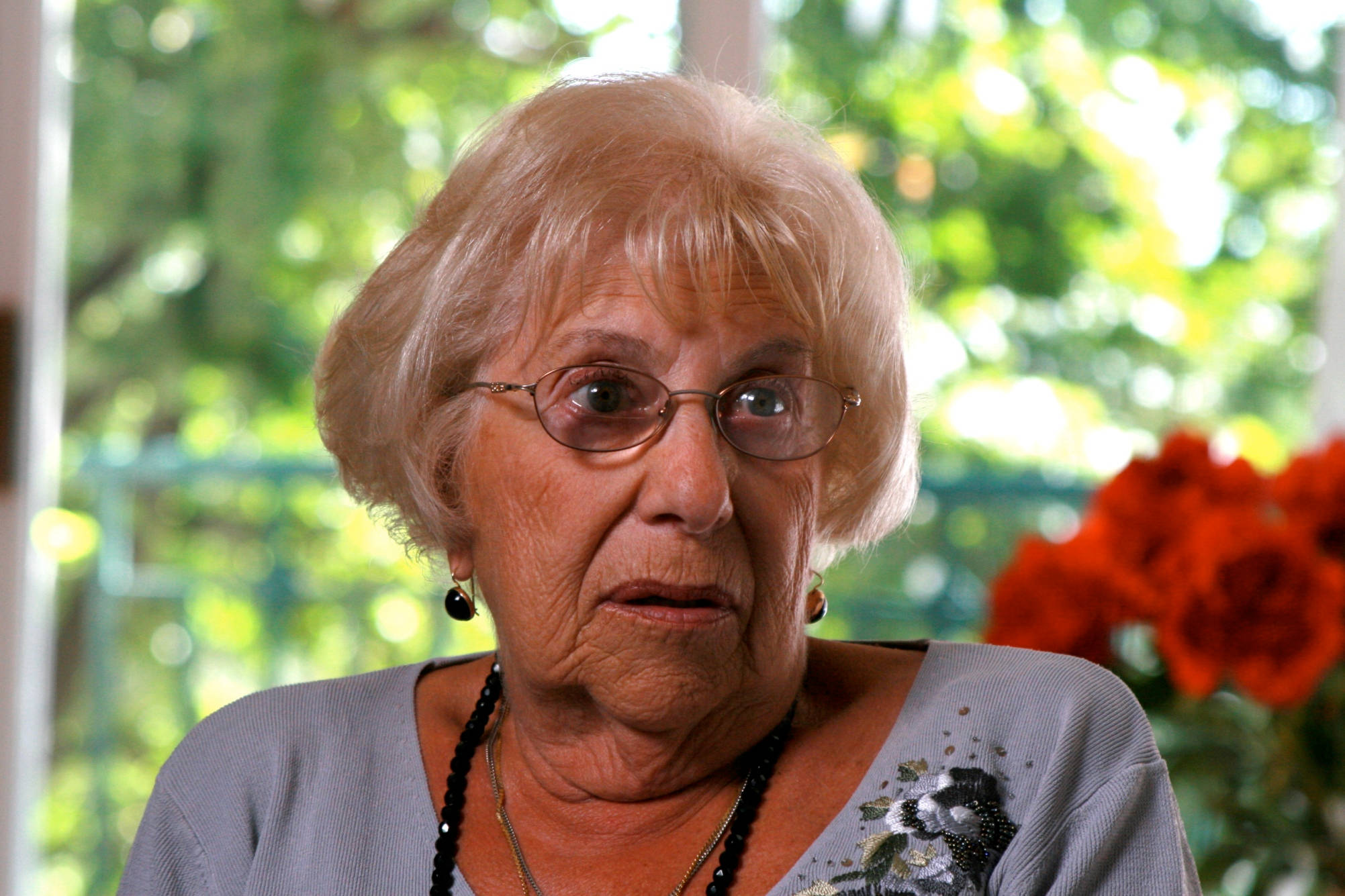 Holocaust survivor Sia Hertsberg as she is interviewed for the documentary, Rumbula's Echo.